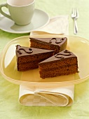 Three pieces of Sacher torte on platter
