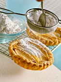 Apple and marzipan tarts with icing sugar