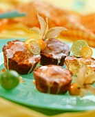Pineapple muffins with limes and cape gooseberries