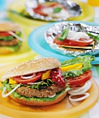 Home-made hamburgers and barbecued vegetables parcels