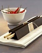 Home-made chopstick holder and bowl of chili peppers