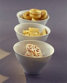 Bowl of lotus roots, sesame crackers and bread rings