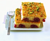 Quick cherry cake with chopped pistachios