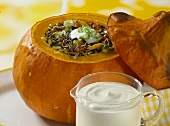 Pumpkin with wild rice stuffing; crème fraiche