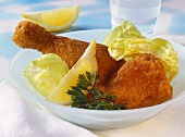 Viennese fried chicken with lettuce & lemon garnish