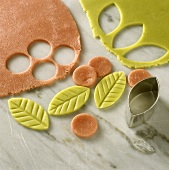 Cutting out marzipan leaves
