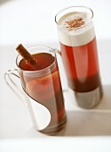 Two glasses of tea with cinnamon and with cream