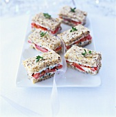 Small tomato and soft cheese sandwiches
