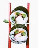 Two maki-sushi with surimi and green asparagus