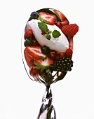 Yoghurt ice cream with fresh berries on spoon