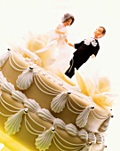Decorated marzipan-covered cake with bride and groom