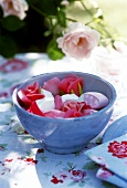 Bowl of marzipan roses and marshmallow on summery table