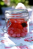 Fruit sweets in a preserving jar