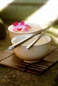 Bowl with chopsticks and with flower