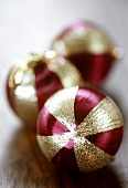 Three Christmas baubles (purple and gold)