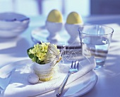 Table setting with flower-filled eggshell