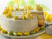 Sponge cake with mango bunnies and sugar eggs