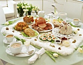 Polish Easter buffet: soup, vegetables in aspic, ham, gugelhupf