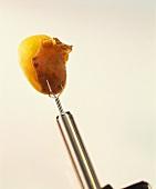 Potato on potato peeling fork