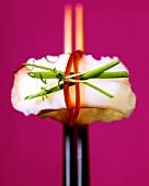 Nigiri-sushi with cuttlefish on chopsticks
