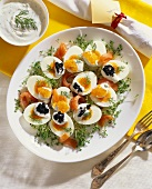 Boiled eggs garnished with salmon and caviare