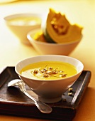 Creamed pumpkin soup with ginger and strips of chili