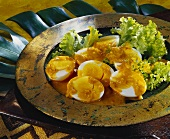 Boiled eggs with curry sauce (S. Africa)