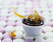 Chocolate mousse with spun sugar on marshmallow background