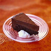 A piece of chocolate cake with cream