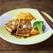 Fried tofu slices with black sesame