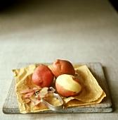 Half-peeled and unpeeled potatoes