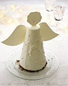 Chocolate cake with white icing, Christmas angel
