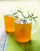 Iced rooibos tea with orange juice and rosemary