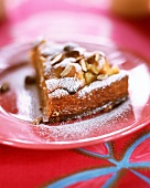 A piece of apple cake with marzipan and almonds
