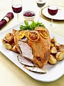 Roast turkey with slices of orange
