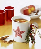 Cup of hot punch with Christmassy decoration