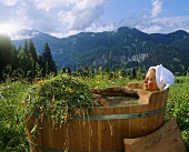 Woman in hay bath
