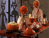 Halloween buffet with pasta salad, muffins and punch