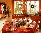 Christmas table with flower arrangement and candles