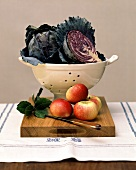 Fresh red cabbage, apples, bay leaves