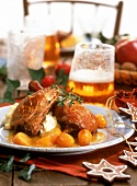 Goose leg with mashed potato and citrus fruits
