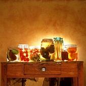 Bottled vegetables and bottled pears in jars
