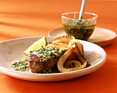 Rump steak with green mojo sauce (from Cuba and Spain)