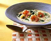 Creole soup with shrimps, vegetables and coconut milk