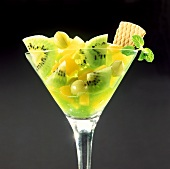 Fruit sundae with kiwi fruit, pineapple and cape gooseberries