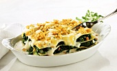 Spinach and ham lasagne with cornflake and cheese topping