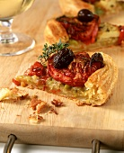 A piece of savoury puff pastry vegetable tart