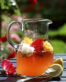 Rose punch in a glass jug