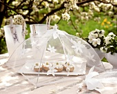 White spring table decoration  (roll & soft cheese under cover)