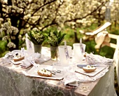 Laid garden table with spring theme & white table decoration